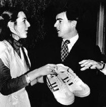 Governor Edmund G. Brown, Jr. receives a pair of jogging shoes from YMCA model legislature's youth Governor (Jill Lawrence)