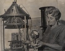Constance Perham with Westinghouse lamp and Herrold broadcasting artifacts, 1972