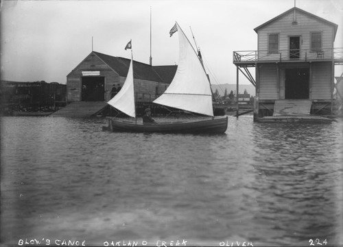 Mr. Blow's sailing canoe at boat house, Oakland Creek. [negative]