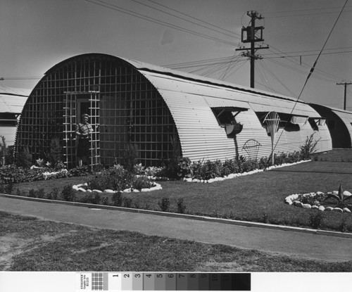 Calisphere photograph of woman at front door of quonset hut in image photograph of woman at front door of quonset hut in rodger solutioingenieria Image collections