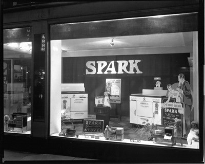 Department Stores - Stockton: Window display of unidentified department store, demonstrating various kinds of stoves of Spark Maufacturing Co