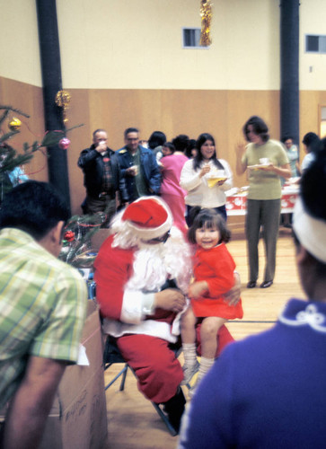 Santa Claus and child at the California Indian Education Association Christmas party--1970