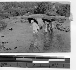 Fr. Edmund Toomey at a stream between Pingnan and Dubang, China, 1932