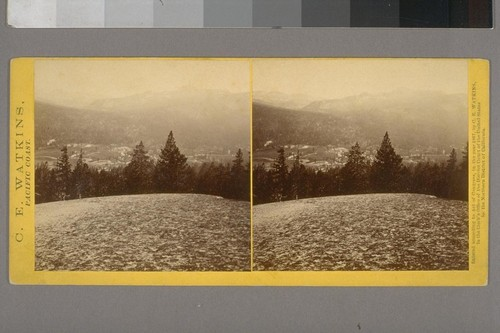 [View from granite high point into river valley with meadows, mountains in background. Yosemite vicinity.]