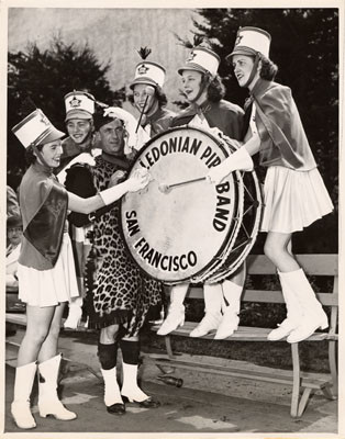 [Drummer Ed Ross assisted by five members of the Victoria, British Columbia, Girls' Drill Team, Golden Gate International Exposition on Treasure Island]