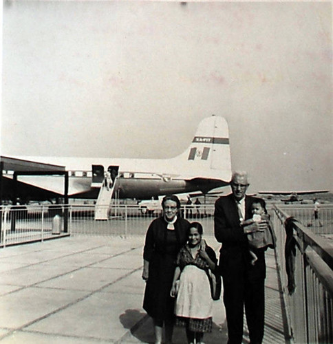 Bess and Oscar Hallberg at the airport in Mexico with their daughter in law Zenaida and one of the grandchildren, circa 1960