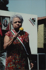 Candelaria Corral With Microphone