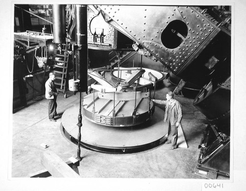 The 100-inch mirror in its hoisting machine, under the 100-inch telescope, Mount Wilson Observatory