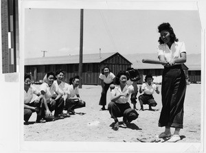 Women playing baseball at the Japanese Relocation Camp, Manzanar, California, July 1942