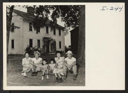 The Kusudo brothers and their families in front of their typical New England house at Red Bird Farm, Wrentham, Mass
