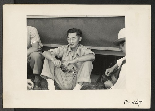 Sacramento, Calif.--Bill Fujii, evacuee of Japanese ancestry, who has completed three years in Commerce at the University of California. He is seen with other young students now spending the duration in War Relocation Authority Center. Photographer: Lange, Dorothea Sacramento, California
