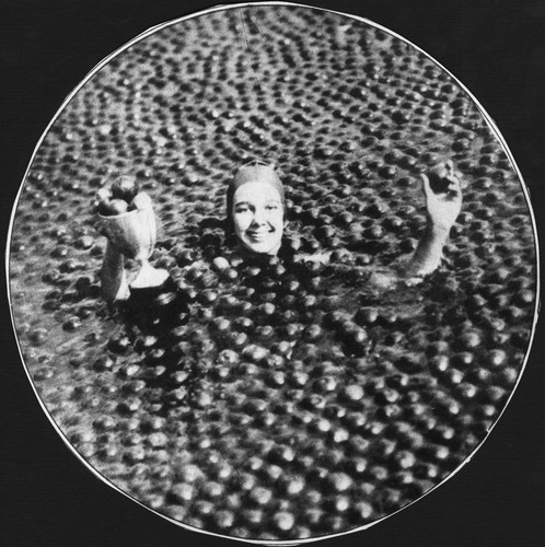Miss Jessie Darnley swims way to title of Miss Anaheim in pool filled with 3 tons of Oranges on April 23, 1929. [graphic]