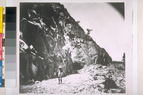 "[""Heading (top cut) of East Portal, Tunnel No. 8."" Unidentified Chinese man working on construction of the Central Pacific Railroad in the Sierra Nevada mountains, near Donner Lake.] [Copy photograph of Alfred. A. Hart's C.P.R.R. stereograph no. 204.]"