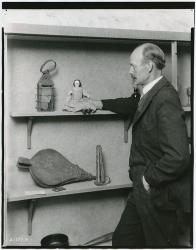 Harry Peterson, Curator, with relics at Sutter's Fort, Sacramento