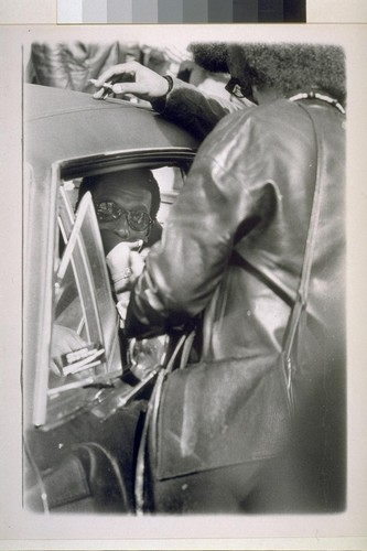 Stokely Carmichael in back seat of car with Kathleen Cleaver