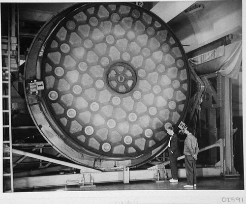 John A. Anderson and Marcus H. Brown inspecting the mirror for the 200-inch reflecting telescope