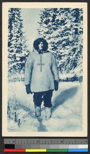 Missionary father standing amid a snowy forest, Canada, ca.1920-1940