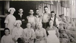 Group of men and women apple workers, about 1920s at an unidentified apple processing building