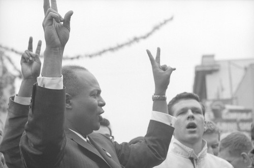 James Farmer giving the V sign at a CORE rally at Bancroft and Telegraph
