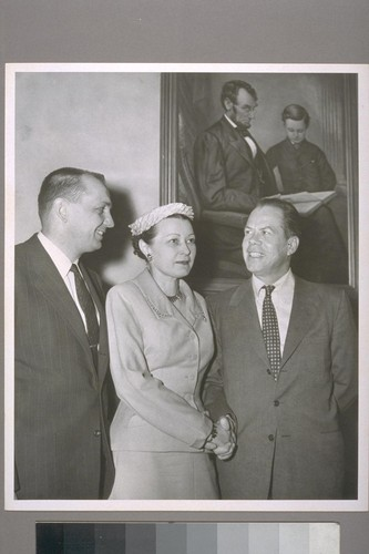 Mrs. Faye Harman, new Head of Federal Housing Administration's San Diego Insuring Office is congratulated by Representative Bob Wilson of San Diego and Senator Thomas H. Kuchel of California following appointment to highest F.H.A. post ever given a woman