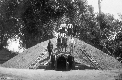 Group of men standing on the Chico Round House (Closeup)