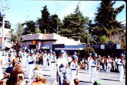 Unidentified marching band with train engineer caps in the Apple Blossom Parade, Sebastopol, California, about 1970
