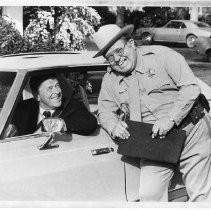 Governor Ronald Reagan films a PSA for the Office of Traffic Safety with Joe Higgins, veteran Hollywood character actor