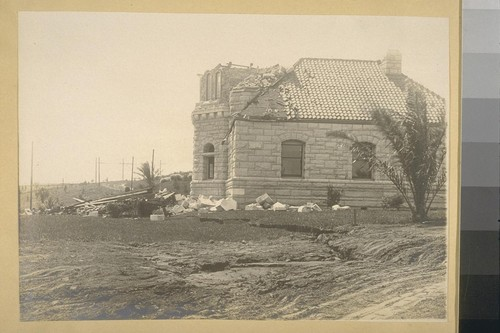 [Earthquake damage to stone building.]