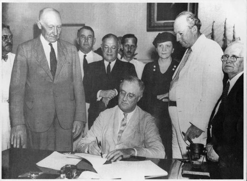 Franklin D. Roosevelt signing the Social Security Bill