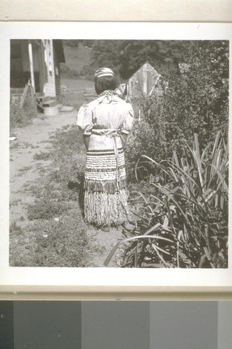 Patty Lopez in ceremonial costume, Smith River, Calif. June 18, 1938