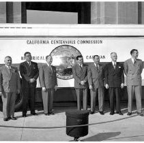 Dignitaries in front of bus at Los Angeles Coliseum, Jan. 31 1949. Aubrey Neasham, center