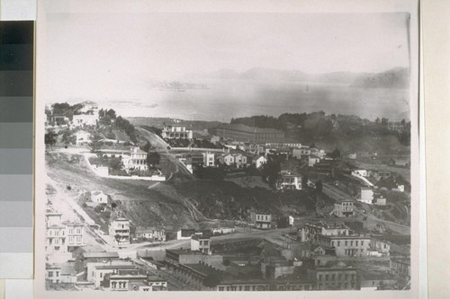 Black Point. Montgomery Avenue being cut through in foreground; Fontana Warehouse in center distance [the Pioneer Woolen Mill]; Fort Mason; Fort Winfield Scott in distance. Ca. 1878
