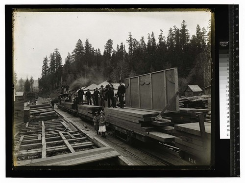 [Glendale Mill with a group of men and two girls posing with a train of lumber]