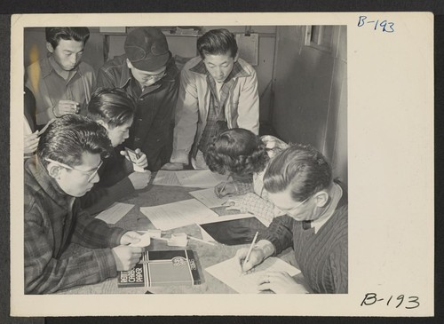 A view in the block manager's office, where evacuees signed up for indefinite leave registration clearance. Photographer: Stewart, Francis Manzanar, California