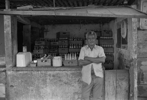 Man selling drinks at city market, Cartagena Province, ca. 1978
