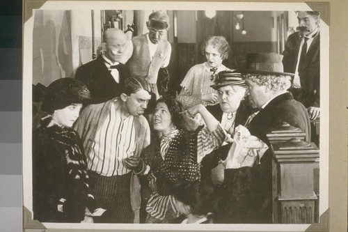 """In some way every one of them felt elated.""... Page 112. [Zasu Pitts, left; Jean Hersholt (next to her); Gibson Gowland, right, in hat.]"