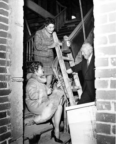 Los Amigos: Two ladies and a man posed on Pico House staircase