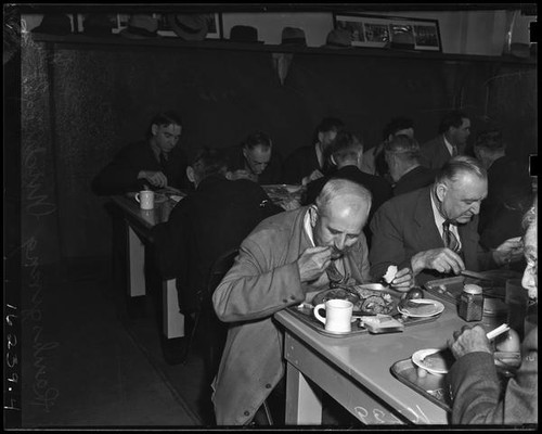 Men enjoy Thanksgiving dinner at the Midnight Mission, Los Angeles, November 25, 1937