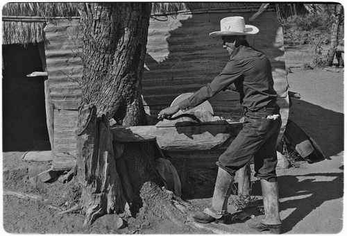 Rancher sharpening machete in Misión Guadalupe area