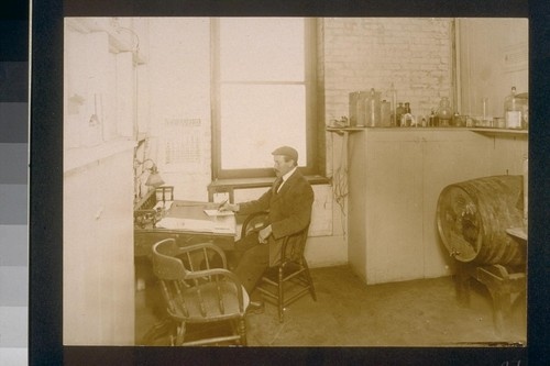 [Unidentified man at desk.]