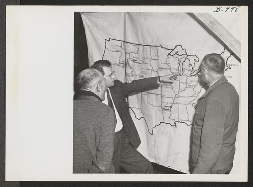Harold Fistere, Relocation Supervisor from Cleveland, and Elmer Shirrell, Relocation Supervisor from Chicago, discuss their respective areas with an evacuee during a recent visit of a Relocation Team to Rohwer Relocation Center. Photographer: Van Tassel, Gretchen McGehee, Arkansas
