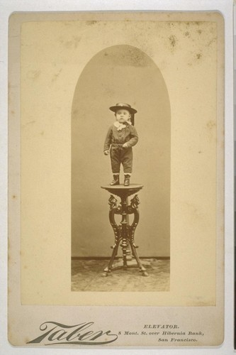 [Portrait of unidentified child standing on pedestal. Photograph by Isaiah West Taber.]