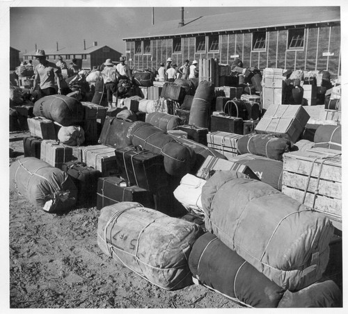 Eden, Idaho--The baggage, belonging to evacuees who have just arrived from the assembly center at Puyallup, Washington, is sorted and trucked to their barrack apartments. Photographer: Stewart, Francis Hunt, Idaho