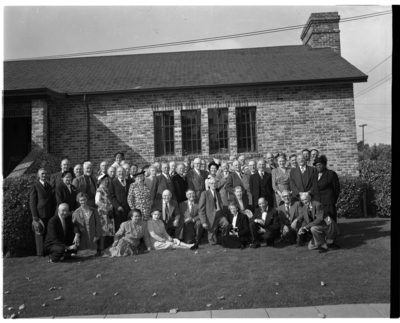 Group photograph in front of brick building