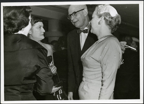 Charles Protzman and his wife socializing