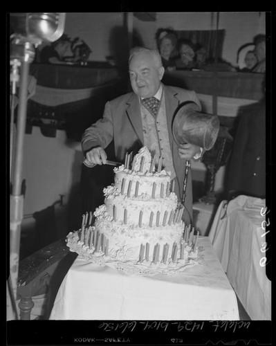 Mayor Fletcher Bowron Cutting A Birthday Cake Marking The Centennial Anniversary For City Of Los