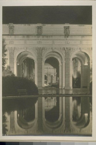 H154. [Colonnade, Court of Four Seasons (Henry Bacon, architect). Looking through to Aisle of Sunset and rotunda, Palace of Fine Arts, illuminated.]