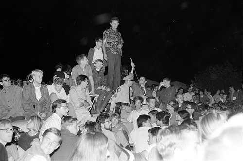 Art Goldberg and other students surrounding and on top of the policecar during night of Oct. 1, 1964