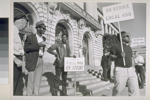 (Left to right) Patrolman Henry Stokes talks with picketers Norman Roberts and Carlin Vance, (both of S.E.I.U. local 66) at City Hall as picketing continued
