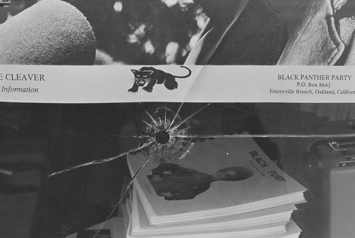Bullet Hole in plate glass window of Black Panther Party National Headquarters, Oakland, CA, #1 from A Photographic Essay on The Black Panthers